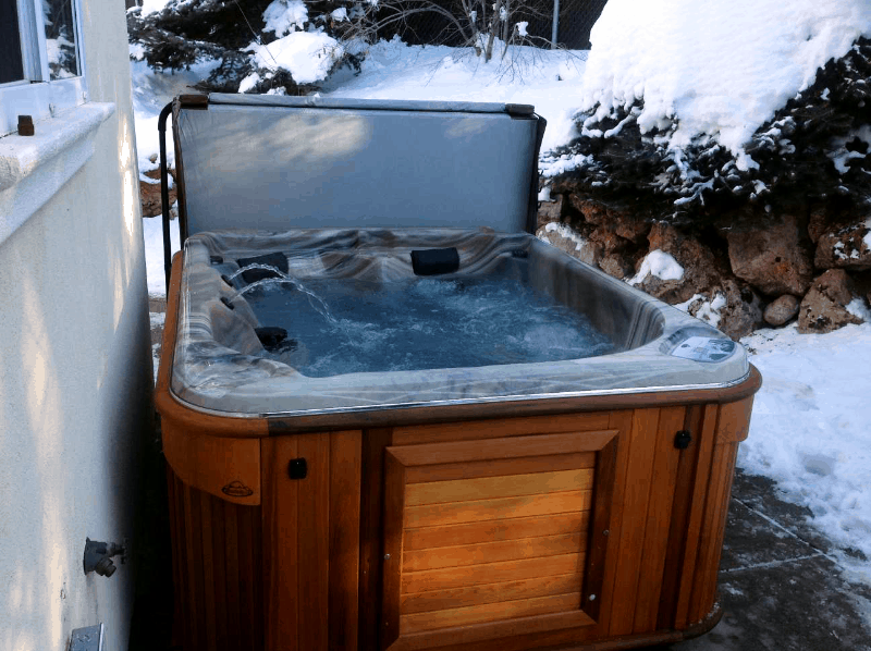 Arctic Spas Hot tub in the backyard in winter